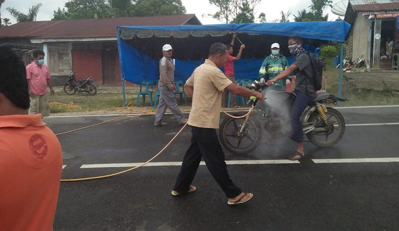 Penyermprotan Disinfektan Kendaraan Masuk