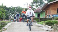 Bupati Taput Nikson Nababan Nginap dan Keliling Gowes Sepeda Sapa Masyarakat Pulau Sibandang.